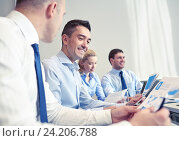 Купить «smiling business people meeting in office», фото № 24206788, снято 25 октября 2014 г. (c) Syda Productions / Фотобанк Лори