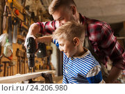 Купить «father and son with drill working at workshop», фото № 24206980, снято 14 мая 2016 г. (c) Syda Productions / Фотобанк Лори