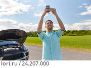 Купить «man with smartphone and broken car at countryside», фото № 24207000, снято 12 июня 2016 г. (c) Syda Productions / Фотобанк Лори