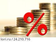 Купить «Красный знак процента на фоне денег .  Концепция изменения банковских ставок .», фото № 24210716, снято 22 октября 2016 г. (c) Сергеев Валерий / Фотобанк Лори