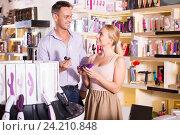 Купить «adult couple buying sex toys in shop», фото № 24210848, снято 23 марта 2019 г. (c) Яков Филимонов / Фотобанк Лори