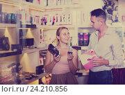 Купить «Happy family couple buying sex toys in store», фото № 24210856, снято 23 марта 2019 г. (c) Яков Филимонов / Фотобанк Лори