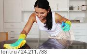 Купить «Brunette clean up house», видеоролик № 24211788, снято 31 октября 2016 г. (c) Яков Филимонов / Фотобанк Лори