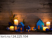 Купить «Christmas background with paper toys», фото № 24225104, снято 13 ноября 2016 г. (c) Майя Крученкова / Фотобанк Лори