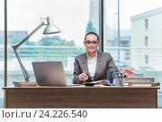 Купить «Young assistant working in the office», фото № 24226540, снято 15 августа 2016 г. (c) Elnur / Фотобанк Лори