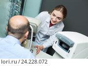 Купить «Female optician doing eye examination with aid of slit lamp», фото № 24228072, снято 20 июля 2018 г. (c) Яков Филимонов / Фотобанк Лори