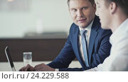 Купить «Business people in office», видеоролик № 24229588, снято 7 декабря 2019 г. (c) Raev Denis / Фотобанк Лори