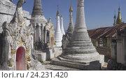 Купить «Храмовый комплекс Шве-Инн-Тхейн-Пайя в Мьянме», видеоролик № 24231420, снято 16 ноября 2016 г. (c) Михаил Коханчиков / Фотобанк Лори