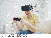 Купить «man in virtual reality headset with controller», фото № 24235632, снято 12 марта 2016 г. (c) Syda Productions / Фотобанк Лори