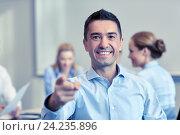 Купить «group of smiling businesspeople meeting in office», фото № 24235896, снято 25 октября 2014 г. (c) Syda Productions / Фотобанк Лори