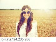 Купить «smiling young hippie woman on cereal field», фото № 24235936, снято 27 августа 2015 г. (c) Syda Productions / Фотобанк Лори