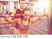 Купить «man and woman with barbell flexing muscles in gym», фото № 24236740, снято 30 ноября 2014 г. (c) Syda Productions / Фотобанк Лори