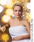 Купить «beautiful young woman sitting in bath towel», фото № 24236756, снято 15 декабря 2014 г. (c) Syda Productions / Фотобанк Лори