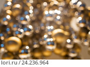 Купить «golden christmas decoration or garland of beads», фото № 24236964, снято 3 ноября 2016 г. (c) Syda Productions / Фотобанк Лори