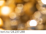 Купить «blurred golden christmas lights bokeh», фото № 24237288, снято 3 ноября 2016 г. (c) Syda Productions / Фотобанк Лори