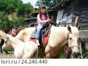 Купить «Девочка сидит на коне», фото № 24240440, снято 25 мая 2014 г. (c) Марина Володько / Фотобанк Лори