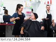 Купить «Happy woman hairdresser cutting female client», фото № 24244584, снято 9 апреля 2020 г. (c) Яков Филимонов / Фотобанк Лори
