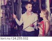 Купить «Young adult couple buying sex accessories in shop», фото № 24255032, снято 23 марта 2019 г. (c) Яков Филимонов / Фотобанк Лори