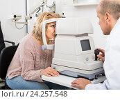 Купить «Checking eyesight in clinic», фото № 24257548, снято 20 июля 2018 г. (c) Яков Филимонов / Фотобанк Лори