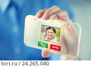 Купить «close up of hand with incoming call on smartphone», фото № 24265040, снято 13 августа 2015 г. (c) Syda Productions / Фотобанк Лори