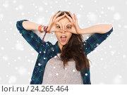 Купить «happy teenage girl making face and having fun», фото № 24265464, снято 19 декабря 2015 г. (c) Syda Productions / Фотобанк Лори