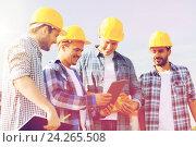 Купить «group of smiling builders with tablet pc outdoors», фото № 24265508, снято 21 сентября 2014 г. (c) Syda Productions / Фотобанк Лори