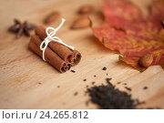 Купить «cinnamon, maple leaf and almond on wooden board», фото № 24265812, снято 13 октября 2016 г. (c) Syda Productions / Фотобанк Лори