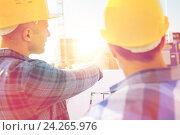 Купить «close up of builders with blueprint at building», фото № 24265976, снято 21 сентября 2014 г. (c) Syda Productions / Фотобанк Лори