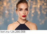 Купить «beautiful woman in black over dark background», фото № 24266008, снято 14 апреля 2016 г. (c) Syda Productions / Фотобанк Лори