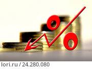 Купить «Красный знак процента на фоне денег», фото № 24280080, снято 22 октября 2016 г. (c) Сергеев Валерий / Фотобанк Лори