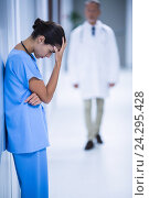 Купить «Depressed female surgeon leaning against wall», фото № 24295428, снято 10 сентября 2016 г. (c) Wavebreak Media / Фотобанк Лори
