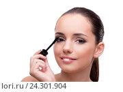 Купить «Woman brushing eyelashes isolated on white», фото № 24301904, снято 21 сентября 2016 г. (c) Elnur / Фотобанк Лори