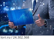 Купить «Businessman holding screen with market quotes», фото № 24302368, снято 26 мая 2020 г. (c) Elnur / Фотобанк Лори
