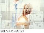 Купить «He is building his business», фото № 24305124, снято 3 сентября 2015 г. (c) Sergey Nivens / Фотобанк Лори
