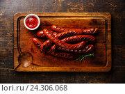 Купить «Колбаски на гриле», фото № 24306068, снято 26 июля 2016 г. (c) Лисовская Наталья / Фотобанк Лори