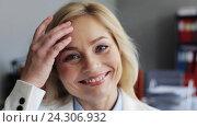 Купить «face of happy smiling middle aged woman at office», видеоролик № 24306932, снято 14 октября 2016 г. (c) Syda Productions / Фотобанк Лори