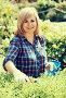 woman horticultural tools, фото № 24311560, снято 17 июня 2016 г. (c) Яков Филимонов / Фотобанк Лори