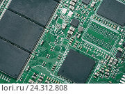 Купить «Электронная плата с чипом», фото № 24312808, снято 26 ноября 2016 г. (c) Александр Лычагин / Фотобанк Лори