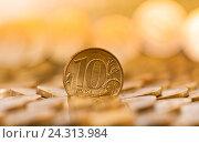 Купить «Монета номиналом в десять рублей среди рядов других монет, тональная коррекция», фото № 24313984, снято 23 июля 2016 г. (c) E. O. / Фотобанк Лори