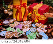 Купить «Christmas gingerbread cookies decoration and gift box.», фото № 24318604, снято 30 ноября 2016 г. (c) Gennadiy Poznyakov / Фотобанк Лори