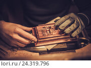 Купить «Jeweler at work in jewelery workshop», фото № 24319796, снято 2 декабря 2016 г. (c) Andrejs Pidjass / Фотобанк Лори
