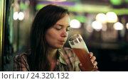 Купить «girl drinking beer at bar», видеоролик № 24320132, снято 3 октября 2016 г. (c) Яков Филимонов / Фотобанк Лори