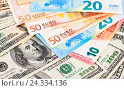 Money background from american dollars and euro banknotes, фото № 24334136, снято 4 декабря 2016 г. (c) FotograFF / Фотобанк Лори