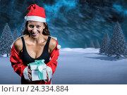 Купить «Composite image of portrait of cheerful athlete in christmas costume and holding present», фото № 24334884, снято 20 марта 2019 г. (c) Wavebreak Media / Фотобанк Лори