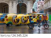 Купить «Coconut palm taxi, Coco taxi, historical Old Town Havana, Habana Vieja, Cuba, the Greater Antilles, the Caribbean, Central America, America», фото № 24345224, снято 4 декабря 2015 г. (c) mauritius images / Фотобанк Лори