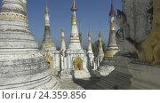 Купить «Walking in Shwe Inn Thein Paya temple complex», видеоролик № 24359856, снято 16 ноября 2016 г. (c) Михаил Коханчиков / Фотобанк Лори