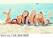 Купить «Young girls lying on beach», фото № 24364868, снято 21 июля 2019 г. (c) Яков Филимонов / Фотобанк Лори