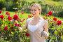 young female gardener caring roses, фото № 24364924, снято 6 декабря 2016 г. (c) Яков Филимонов / Фотобанк Лори