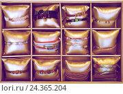 Купить «bracelets in bijouterie store», фото № 24365204, снято 19 сентября 2018 г. (c) Яков Филимонов / Фотобанк Лори