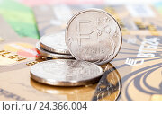 Russian rubles coins over different credit cards close up, фото № 24366004, снято 6 декабря 2016 г. (c) FotograFF / Фотобанк Лори